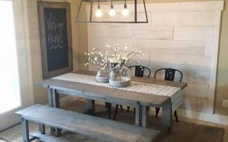 warm feel rustic breakfast nook wooden bench seat black plastic dining chairs hard wood dining table thicker woven area rug