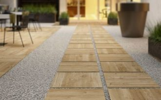 wood paver walkway for outdoor supported by hard textured concrete base