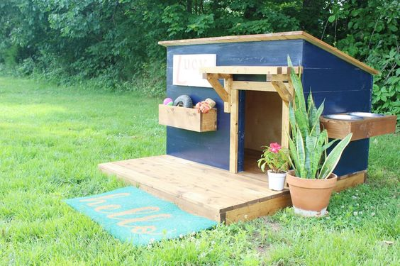wooden doghouse in deep blue color