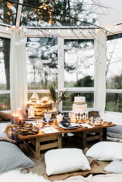 Hygge inspired dining space some floor pillow seats rustic dining table