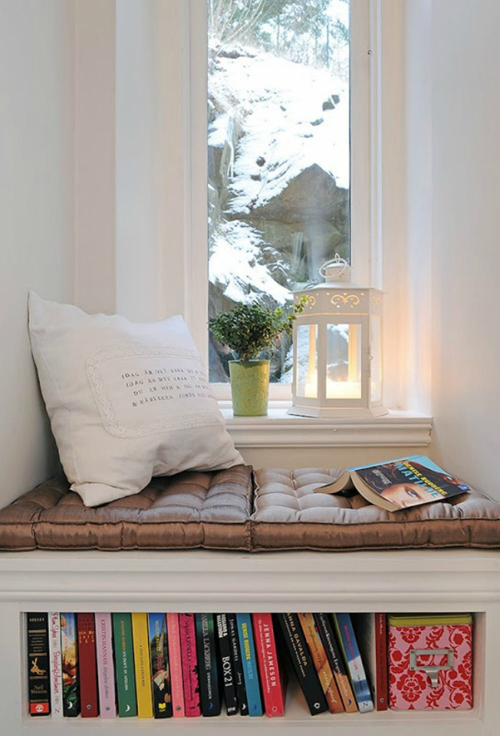 Hygge window seat idea tufted pillow seats in brown white throw pillow under bookcase lantern