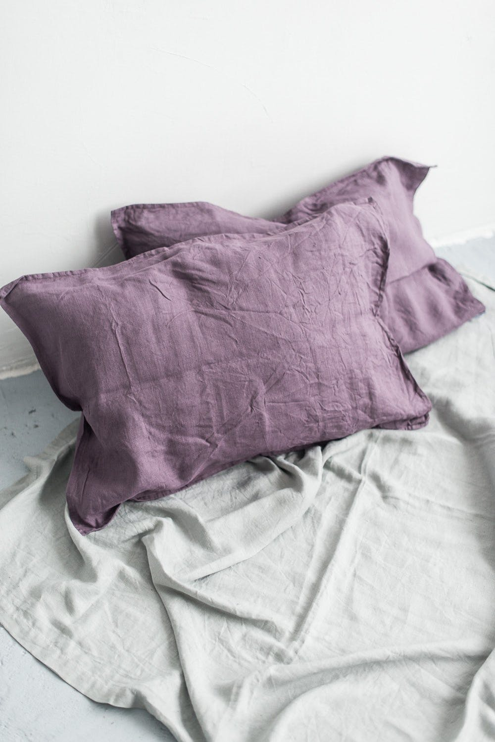 Line Fox's dusty lavender pillow cases light gray bed linen