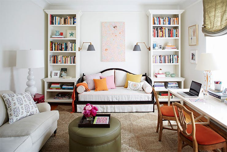 a couple of bookcase with centered daybed