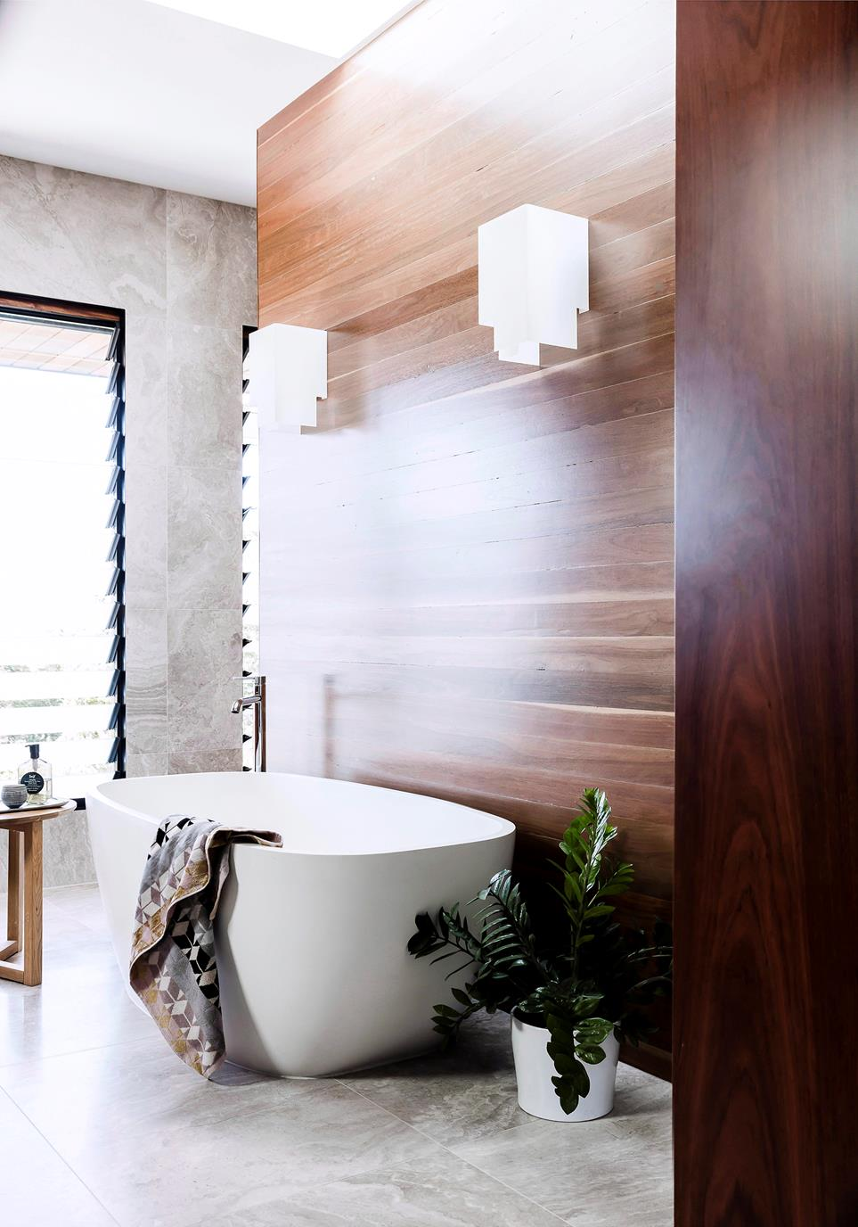 bathroom trend with zen like feel by wood color modern white bathtub small size seat piece
