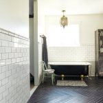 Black Herringbone Tile Floors White Subway Tile Walls Classic Bathtub In White Black Striped Bathroom Mat