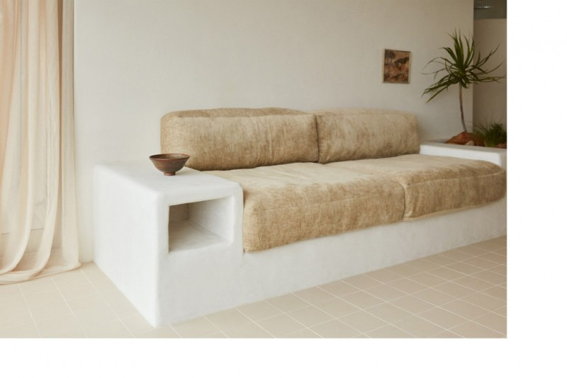creative seating area consisting of concrete bench with flufy foam and armrests on either sides