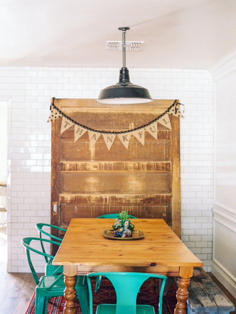 eclectic dining room grandma's dining storage wooden dining table plastic dining chairs in blue radiant subway tile walls in white