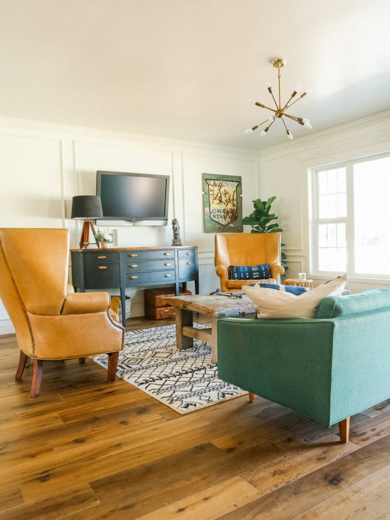 eclectic living room vintage style living room furniture set blue tv console table wood floors monochromatic area rug