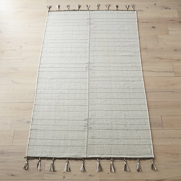 flat weave area rug with rug pad behind