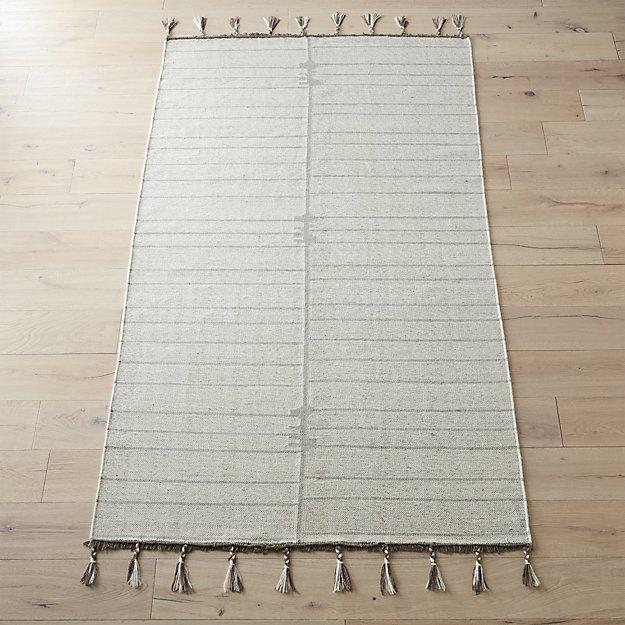 flat weave area rug with rug pad behind