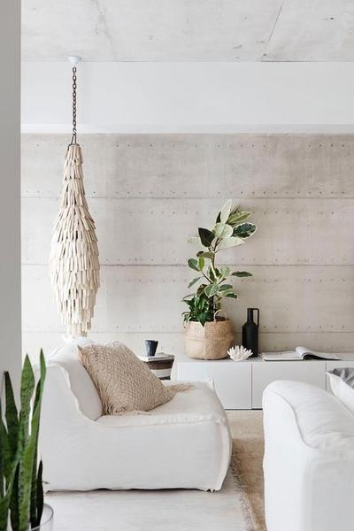 light & minimalist living room potted houseplant light grey walls white upholstered sofas