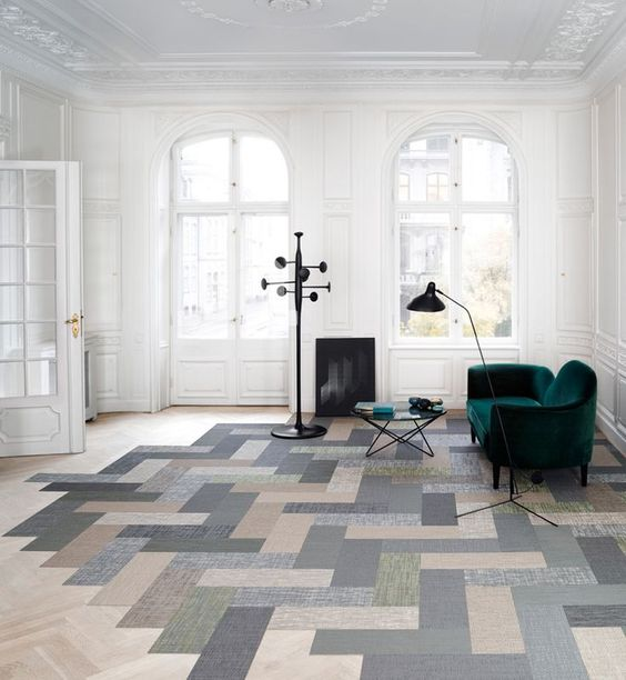 light wood herringbone tiles highlighted by beautiful stains dark & bold furnishing sets dark floor lamps a pop art