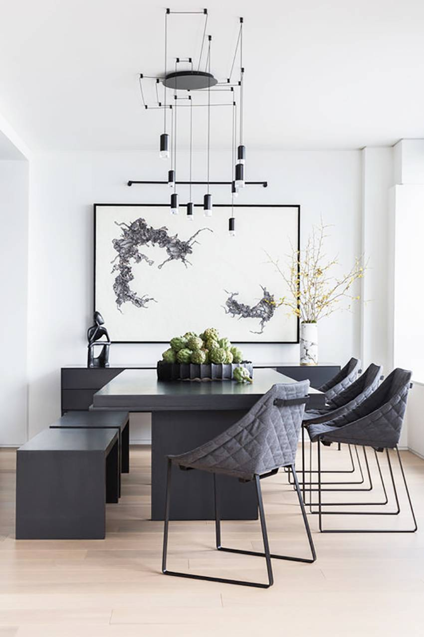 minimalist dining room dark gray dining furniture dark gray hall buffet monochromatic painting light wood floors