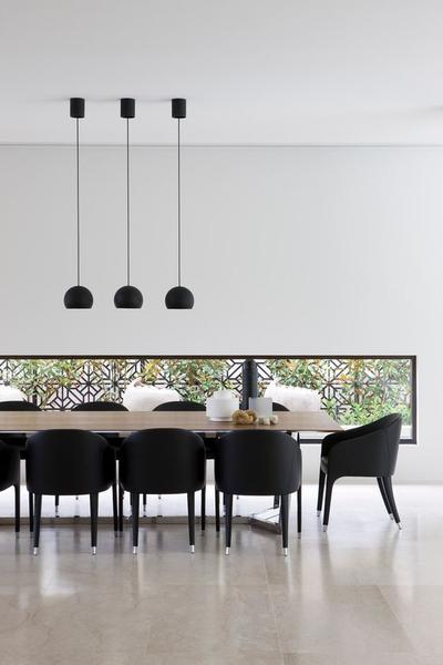 modern minimalist dining room modern pendants in black modern dining chairs in black wood dining table green wall decor in black frame