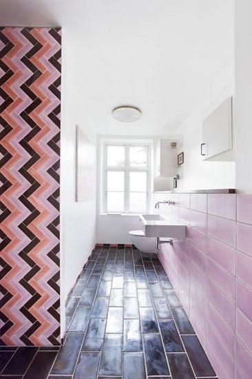 narrow bathroom design soft pink tile walls black tile floors black pink chevron tile accent wall