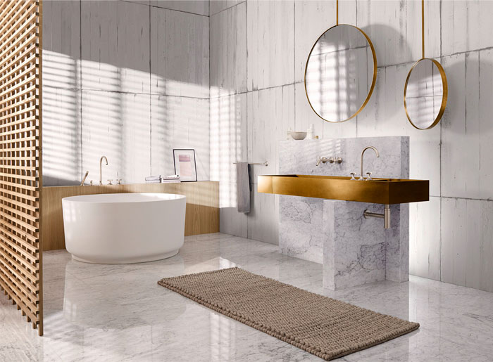 open space bathroom design large size tile walls marble floors marble bathroom vanity with gold toned countertop japan inspired deep tub in white woven rug round mirror