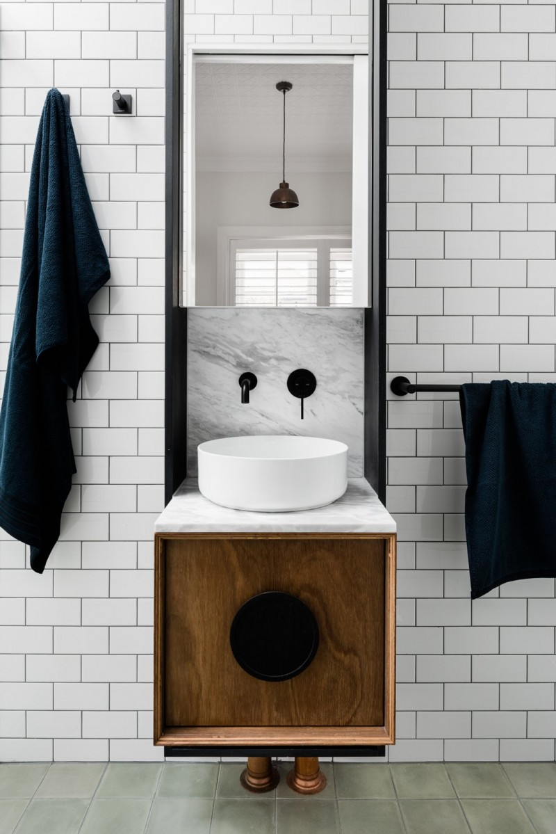 past present bathroom design white subway tile walls black framed mirror smaller bathroom vanity with white top