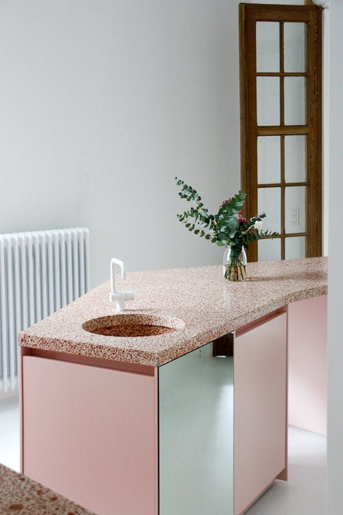 pink terrazzo countertop round shaped undersink white faucet pink kitchen counter