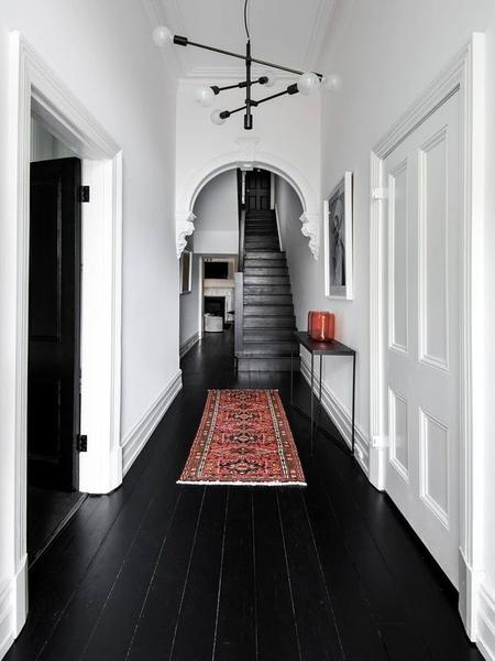 simple modern hallway moroccan runner tiny black hall console table black painted siding floors white walls modern pendants