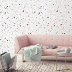Terrazzo Wallpaper Modern Sofa In Pastel Gold Toned Legs Coffee Table With Tempered Glass Surface Neutral Toned Carpet