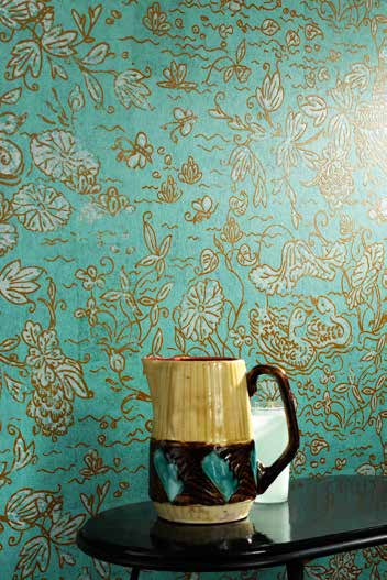 turquoise wallcovering with glossy figurative prints