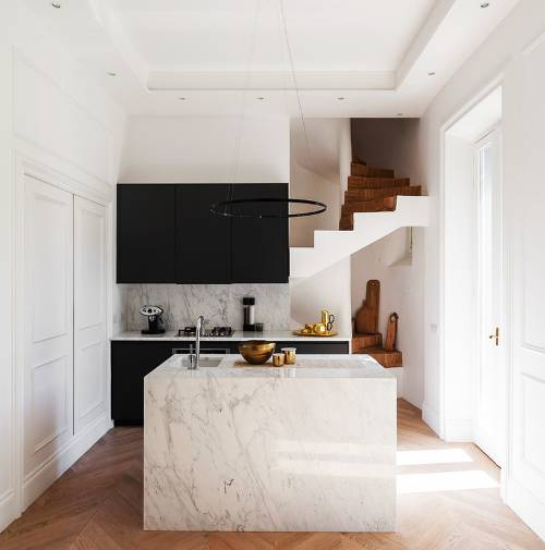Italian style kitchen design  white marble kitchen island with undermount sink black kitchen cabinetry white marble backsplash