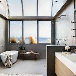 Beachside Bathroom Design Concrete Walls And Floors Sleek Bathtub In White Walk In Shower Standing Bath Faucet Large Sink In White