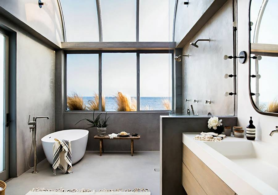 beachside bathroom design concrete walls and floors sleek bathtub in white walk in shower standing bath faucet large sink in white