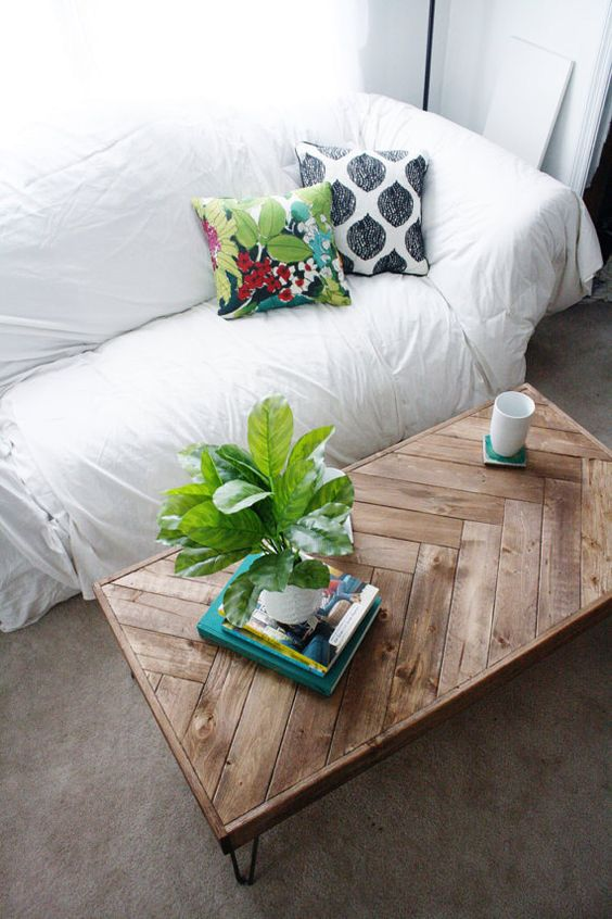 hairpin legs coffee table with herringbone patterns green centerpiece white sofa slipcover