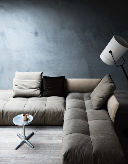 modern sofa in gray with tufted bench cushioning small round top coffee table