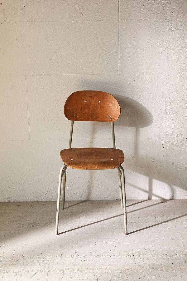 old school chair made of plywood and supported by metal framing