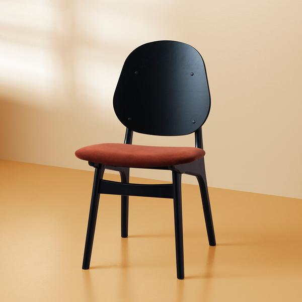 timeless dining chair with sepia colored upholstery seat and solid black wood construction
