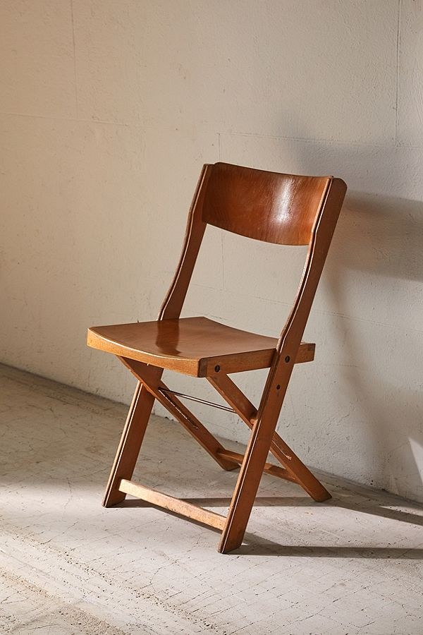 vintage folding chair with contoured shape and sturdy construction