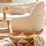 Vintage Living Room Design White Sofa Textured White Throw Pillow Shallow Surface Basket Wooden Center Table With Wood Vase As Centerpiece