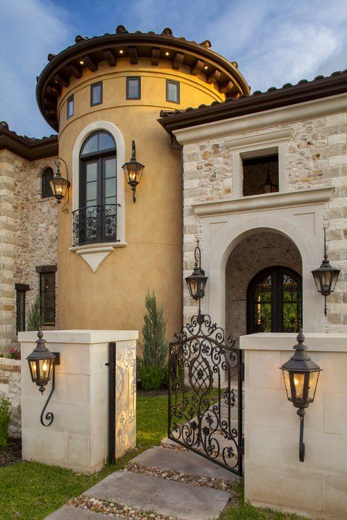 Medieval exterior idea curved front door and windows wrought iron gate door and lighting fixtures