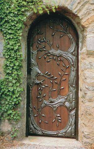 Medieval front door idea with metal floral carvings