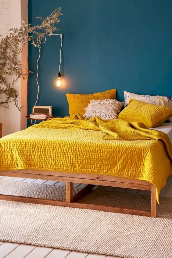 custom wood bed frame yellow quilt with texture yellow pillowcases with texture pendant bulb blue wall paint