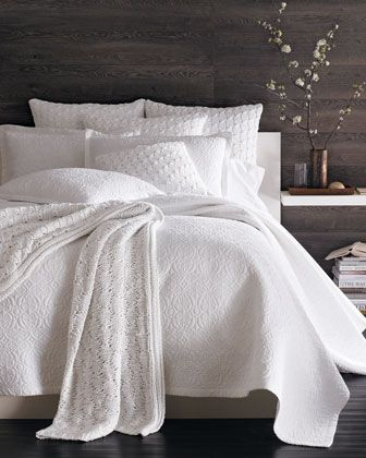 dark stained wood wall textured white bedding product