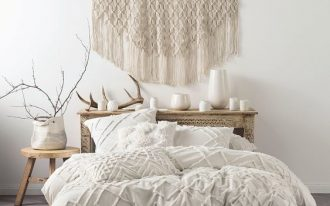 embroidery duvet cover set with textured surface light wood bed frame with headboard wood bedside table decorative woven wool wall art