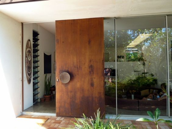 grand size sliding wood door with round shape handle accent