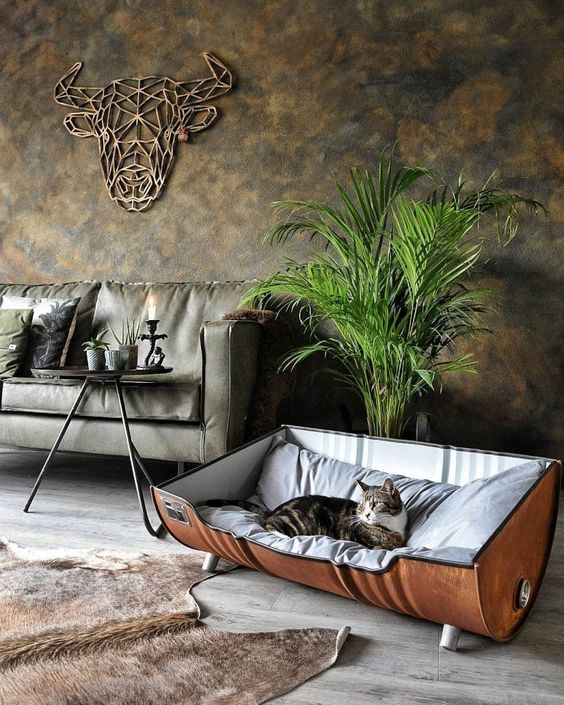 industrial rustic living room idea metal colored couch simple black coffee table creative chair with fluffy mattress concrete floors gray walls with random gold flashes decorative metal head bison
