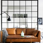 Leather Sofa With Gray Throw Blanket Modern White Area Rug Modern Floor Lamp Black Lined Room Divider