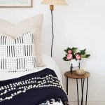 Little Greenery On White Pot Hairpin Leg Side Table With Round Wood Top Wall Mounted Lamp Black White Pillowcase Broken White Pillowcase Dominant Black Blanket