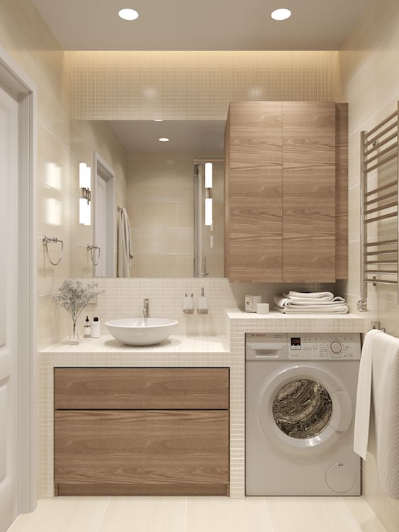 minimalist laundry room light wood cabinetry recessed washing machine mosaic tile countertop & backsplash in white white sink
