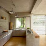 Modern Medieval Kitchen Design Long Lined Kitchen Counter Concrete Finish Walls & Ceilings Wood Floors Modern Kitchen Appliances