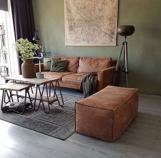 modern living room design light gray wall leather couch in modern style industrial style coffee table with wood top and hairpin legs moroccan area rug