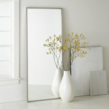 oversize mirror in rectangular shape white ceramic vase with yellow flowers