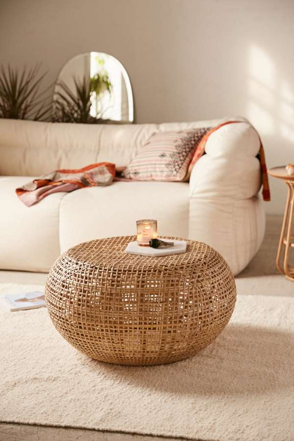rounded wicker coffee table made of wood accented with rattan