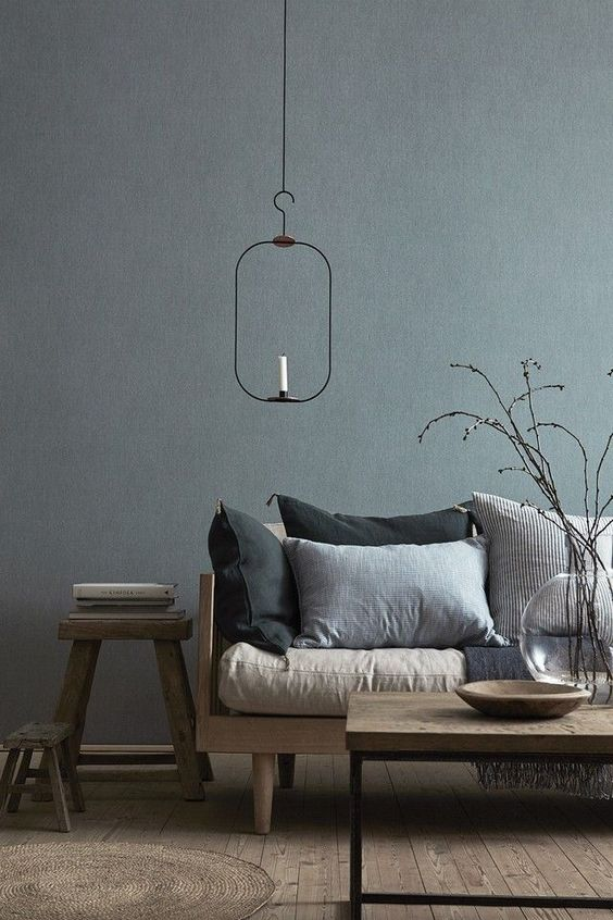 scandinavian living room in gray and neutral palettes light wood furniture set neutral and gray throw pillows unique pendant