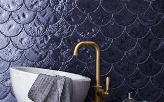 seashell shaped tile wall brass stand faucet modern white sink